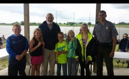 Kids enjoying Fishing Day along with Police Chief Ron Faulkner and Caldwell County Conservation Agent Justin Pyburn