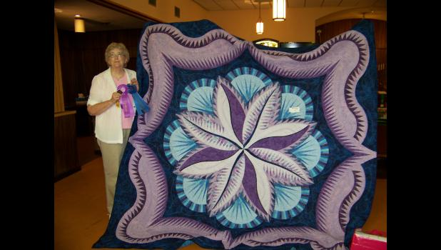 "Pat O'Connor won ""Best of Show"" with her quilt Fire Island Hosta."