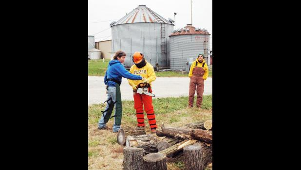 University of Missouri Extension horticulture specialist Katie Kammler gives tips on using chain saws at the recent Pearls of Production event for women livestock operators. Photo by Linda Geist