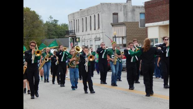 Polo Panther Pride band marching down Main St. in Polo.