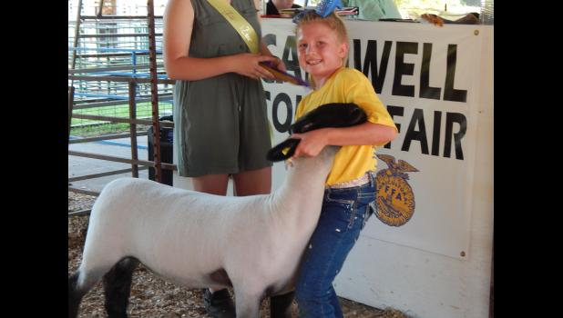 Scarlett Miller shows off her Overall Championship Ewe at the fair.