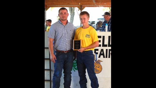 Dustin Davies of Braymer won the Sr. Showmanship Award for Swine. He is pictured with the fair judge, Kent Shikles.
