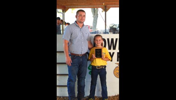 Hadley Corbin won the Jr. Showmanship Award for Swine. She is pictured with the fair judge, Kent Shikles.
