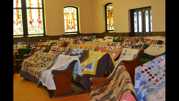 Colorful quilts draped the pews at the Federated Church.