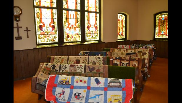 In the forefront of this line of quilts is an adorable quilt made for a special little boy.