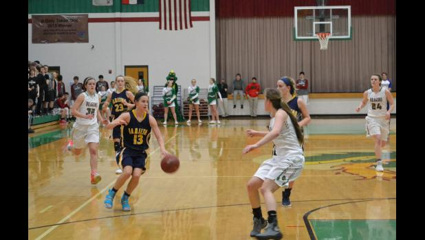 Nora Ford #13 drives into the front court against Mid Buchanan.