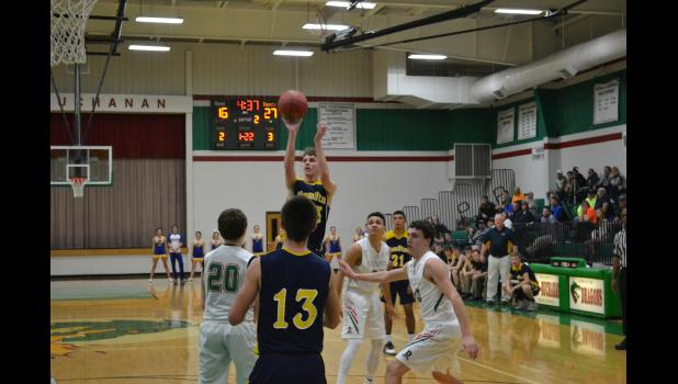 Thane Ward #33 shoots a short jumper against mid Buchanan.