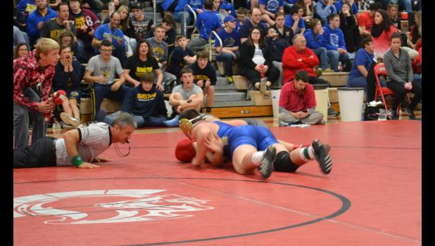 Hamilton's Kenneth Pulley pinned Carrollton's Kilson in this 220 lb. match.