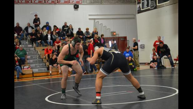 Polo's Luke Cory wrestled Levett Macon in the 195 lb. class.