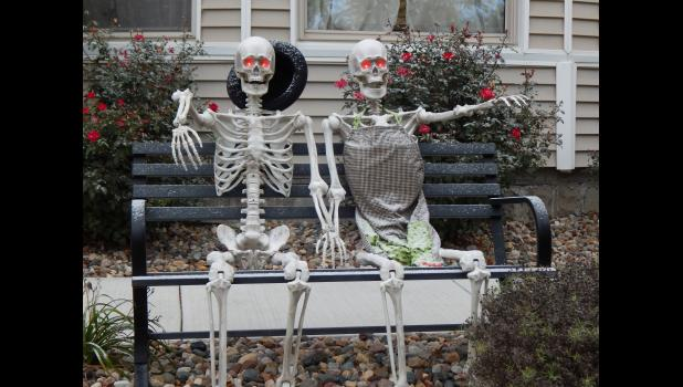 Mr. and Mrs. Skeleton enjoy watching Trick-or-treater's pass by.