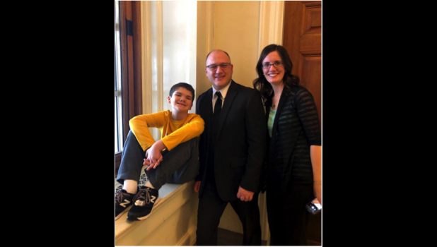 Senato Hoskins poses for a photo with Robyn Schelp and her son, Jacob. The Schelp family has been strong advocates for Senate Bill 45.