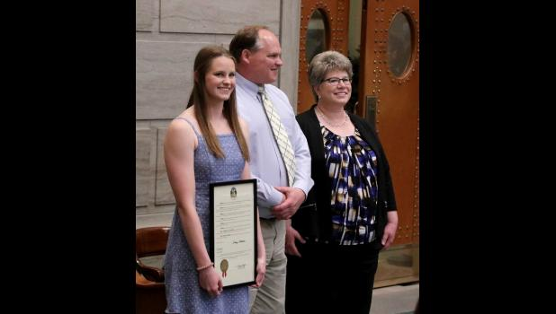 NCAA swim champion Allison Weber and her parents, Mike and Tammy Weber, were introduced in the Missouri Senate chamber.