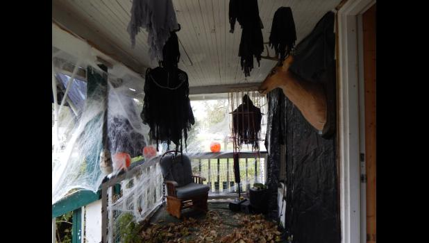 Jim's porch was just as creepy as the front of his house. The talking deer invited trick-or-treater's to come inside.