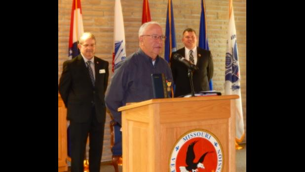 Michael Pollard speaks before his fellow Veterans and guests after receiving his Bronze Star Medal.