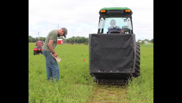 MU researchers use sonar on an all-terrain vehicle to measure forage. The data is transmitted to the MU Grazing Wedge website. The technology can help farmers make decisions about managing their forage inventory. Photo by Linda Geist
