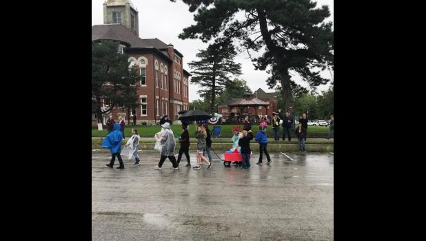 Many people showed up wearing their rain gear and toting their umbrellas for Kingston's celebration. Photo by Eileen Gregory