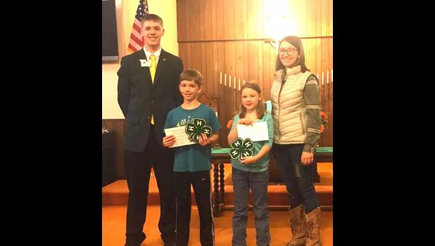 Rookie of the year winners: L to R: Kyle Hanson NW Regional Rep, Brodyn Baragary-Rookie Boy, Kathryn Farmer-Rookie Girl, Ryley Baragary, Caldwell County 4-H Council President