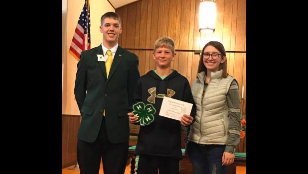 Toomay dedication award: L to R: Kyle Hanson NW Regional Rep, Losson Park- Toomay Dedication Award winner, Ryley Baragary- Caldwell County 4-H Council President