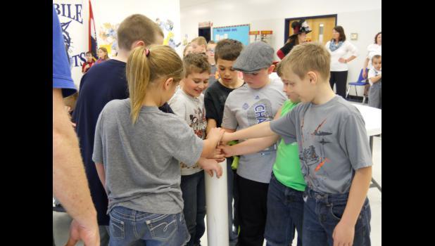 Second grade contributes to the time capsule: Libby Norton, Riley Simmons, Dakota Garrison, Tristan Gibson, Jason Galbraith, Jared Carter and Alex Baker.