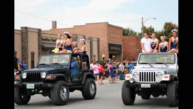 Penney High Cheerleaders escorted in jeeps.