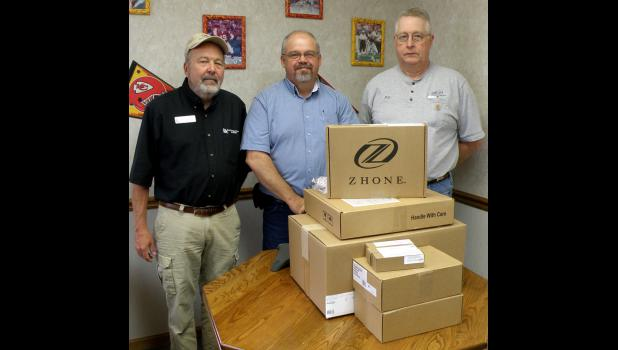Pictured above are State Technical College Lead Instructor of Telecommunications Options Dan Ramsay (left), GHTC Plant Manager Gene Dinwiddie (center), and GHTC Central Office Supervisor Bill Peterson (right) alongside some of the donated fiber optic equipment.
