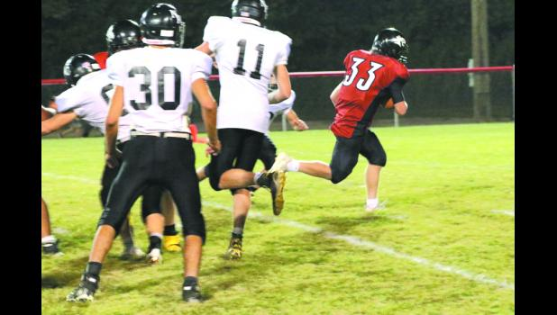 Bobcat Robbie Shoe runs for a touchdown in Braymer's game against Norborne.