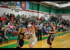 Kassie Moore #23 goes high for this defensive rebound against the Dragons.