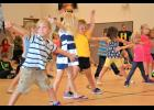 Local preschoolers learn dance moves.